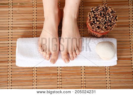 Care for beautiful woman legs on a towel. Beautiful woman legs