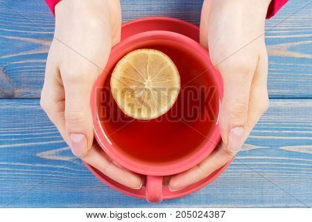Hand Of Woman Holding Cup Of Hot Tea On Table, Warming Beverage