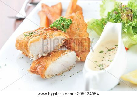 close up fish and chips with French fries