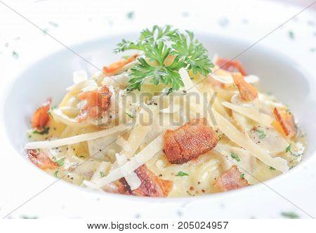 spaghetti with bacon or spaghetti carbonara on plate