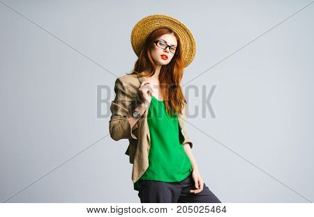 Beautiful stylish young woman in a jacket and hat. Casual business lady