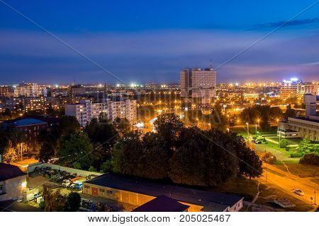 Aerial night Kaliningrad cityscape. View to modern buildings and abandoned House of Councils (House of Soviets)