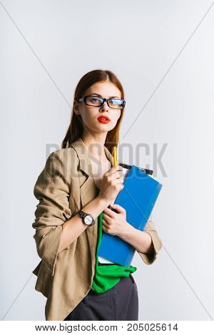 An alarmed young businesswoman in a glasses suit holds documents