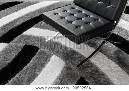 modern leather lounge chair on the rug