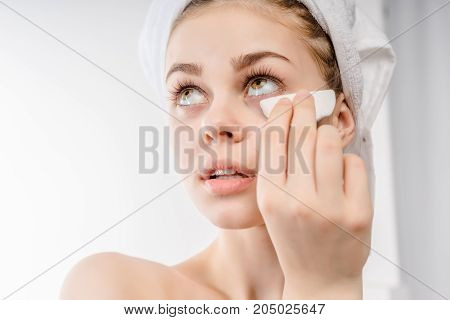 woman with a sponge,cotton pad. problem skin