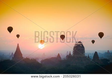 Hot air balloon over plain of bagan in misty morning Mandalay Myanmar