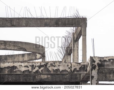 Old reinforced concrete building structure on white background