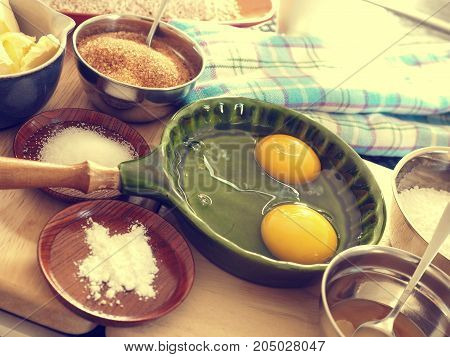 Baking ingredients on a worktop in the kitchen flat tone stylized