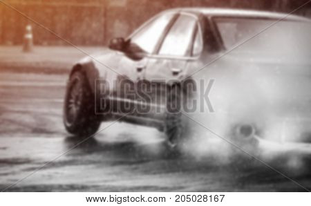 Abstract blurred image or defocused of drifting car on wet track