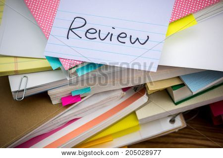 Review; The Pile Of Business Documents On The Desk