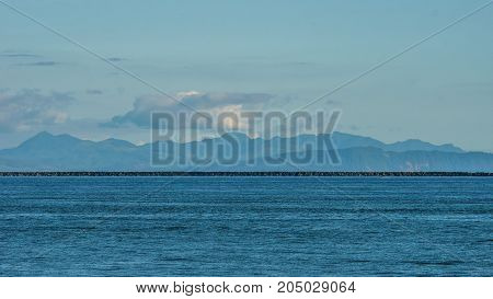 Blue Pacific Ocean With Blue Sky And Blue Mountains.