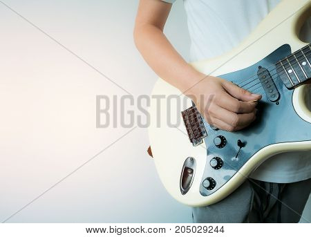 Man playing guitar with left side copy-space