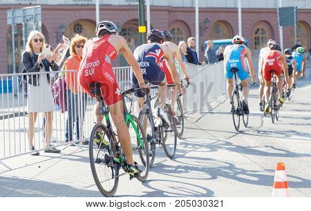 STOCKHOLM - AUG 26 2017: Back of group of colorful triathlete cyclists in the Men's ITU World Triathlon series event August 26 2017 in Stockholm Sweden