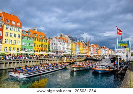 COPENHAGEN, DENMARK - JULY 20: Nyhavn, 17th century waterfront, canal and entertainment district and the popular tourist destination in Copenhagen, Denmark