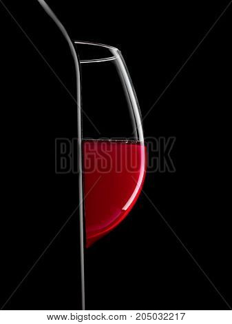 Elegant Silhouette Bottle Of  Red Wine And Glass On Black Background