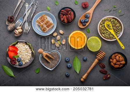 Ingredients For The Healthy Foods Background Mixed Nuts, Honey, Berries, Fruits, Blueberry, Orange,