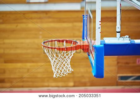 Basketball hoop in the sports hall closeup