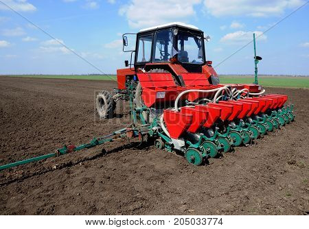 Yahilnytsia - Chortkiv - Ternopil - Ukraine - April 14 2010. Conventional tractor and used for precision seeding the soil in the fields of the agricultural enterprise
