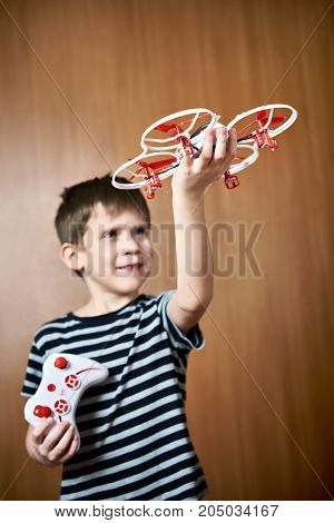 Happy Little Boy With Toy Quadcopter Drone
