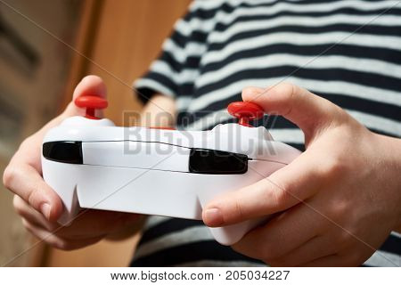 Child Hands Use Remote Control Toy