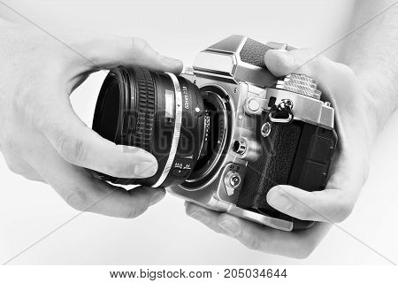 Black And White Photo Slr Camera In Hands Of Photographer