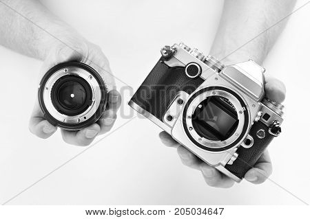 Black And White Photo Slr Camera In Hands Photographer