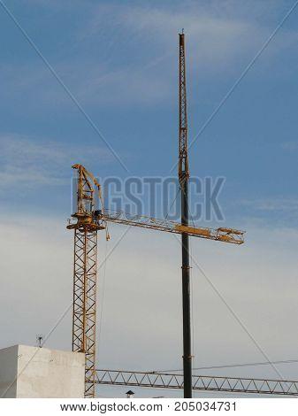 Men Erecting Large Yellow Crane