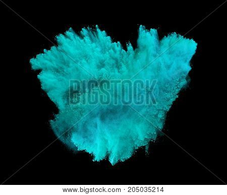 Powder explosion. Closeup of blue dust particle explosion isolated on background.