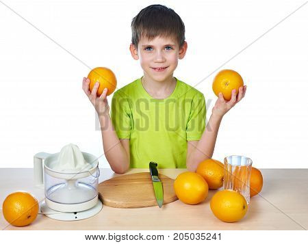 Happy Boy With Oranges And Juicer Isolated