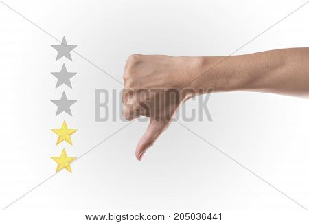 Business hand thumb down with yellow marker on five star rating. concept customer service excellent.