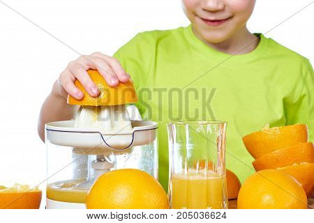 a boy makes orange juice isolated white