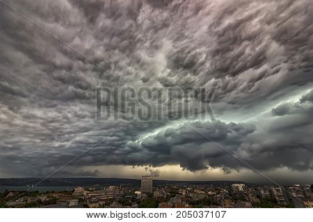 exciting stormy clouds over the city. Panoramic
