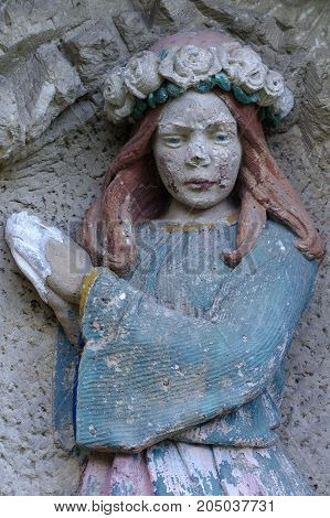 praying girl relief art detail architecture religion