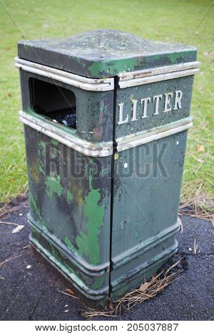 Old litter bin close up shot Garbage concept with copy text