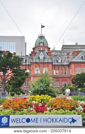 Hokkaido, Japan - July 24, 2013: The Former Hokkaido Government Office with a welcome sign in Sapporo city, Hokkaido, Japan. That Building was first completed in 1888 and known in Red Bricks Building.