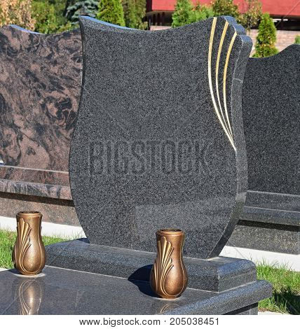 New tombstones in the public cemetery in summer