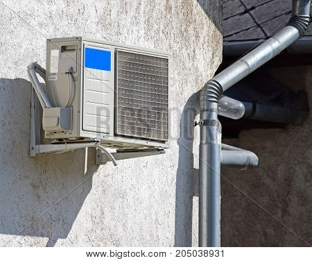 Air conditioner on the wall of a building