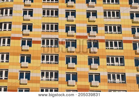 Wall with balconies new modern multi-storey residential buildings , the yellow house, the whole frame