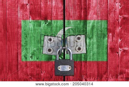 Maldives flag on door with padlock close