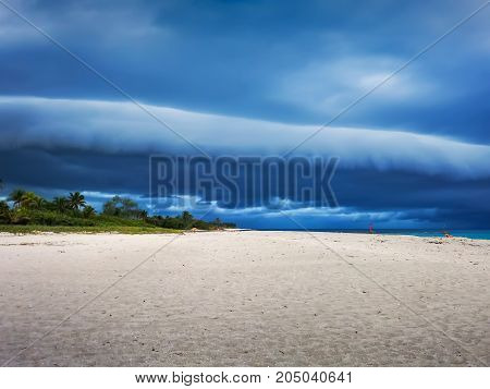 clouds, clouds on the ocean and a stretch of beach in front of the hurricane, Cuba