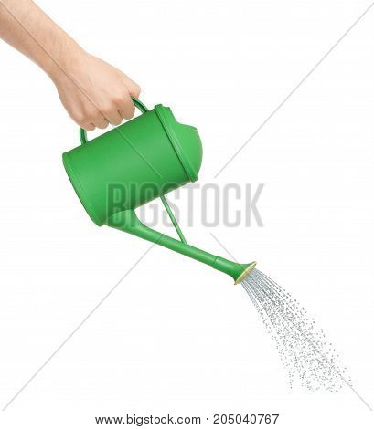 Hand watering from a watering can, conceptual photography