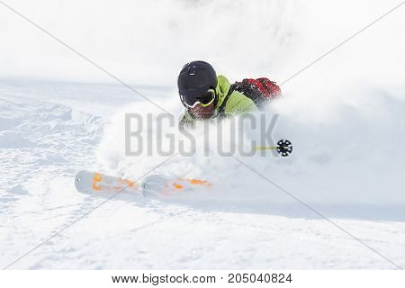 Young man skiing in the snowstorm. Mountains of Kamchatka