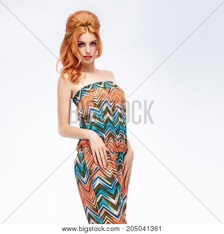 Fashion. Young woman in Summer Outfit, Glamor Pinup hairstyle, Trendy fashion Makeup. Playful Pretty girl in fashion pose. Beautiful Sexy Redhead Model, Stylish Summer Colorful look