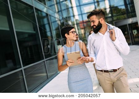 Picture of handsome businessman and beautiful businesswoman on break from work