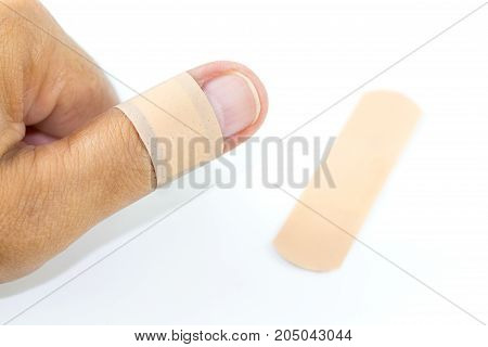 male thumb with bandage on white background. with copy space for text.