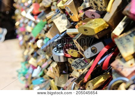 Many love padlocks are attached to the wall