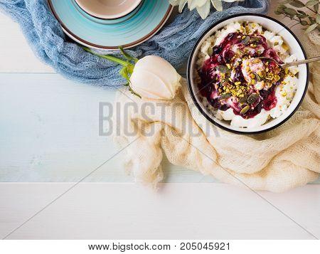 Bowl of yogurt and quark with berry sauce jam. Morning breakfast