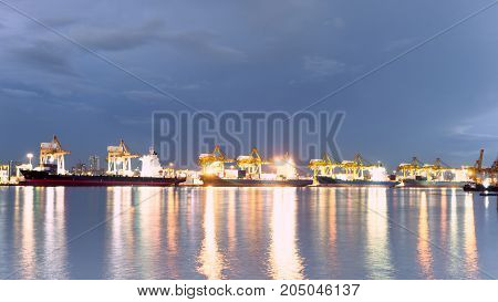 Industrial night business loading containers shipping in the harbor