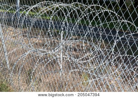 A Wall With Barbed Wire End The Intrusion