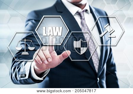 Business, technology, internet concept on hexagons and transparent honeycomb background. Businessman  pressing button on touch screen interface and select  law